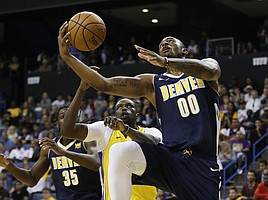 Denver Nuggets' Darrell Arthur drives to the basket as he is followed by Los Angeles Lakers' Luol Deng during the first half of an NBA preseason basketball game, Wednesday, Oct. 4, 2017, in Ontario, Calif. (AP Photo/Jae C. Hong)
