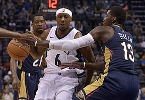 Memphis Grizzlies guard Mario Chalmers (6) drives between New Orleans Pelicans guard Jordan Crawford (27) and forward Cheick Diallo (13) in the second half of an NBA basketball preseason game Friday, Oct. 13, 2017, in Memphis, Tenn. (AP Photo/Brandon Dill)