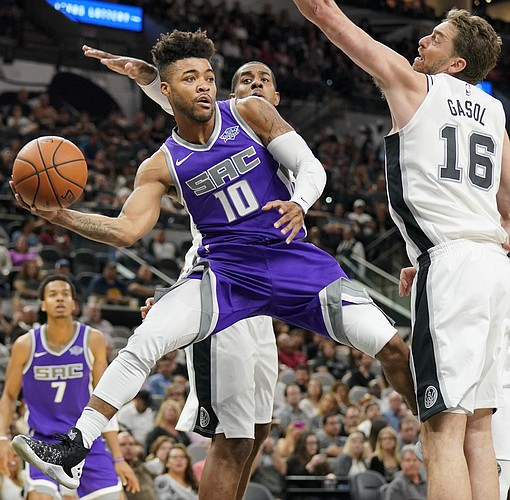 Sacramento Kings' Frank Mason III (10) looks to pass around San Antonio Spurs' Pau Gasol, of Spain during the first half of a preseason NBA basketball game, Friday, Oct. 6, 2017, in San Antonio. (AP Photo/Darren Abate)