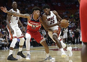 Miami Heat's Justise Winslow (20) drives to the basket as Washington Wizards' Kelly Oubre Jr. (12) defends during the second half of a preseason NBA basketball game, Wednesday, Oct. 11, 2017, in Miami. The Heat won 117-115. (AP Photo/Lynne Sladky)