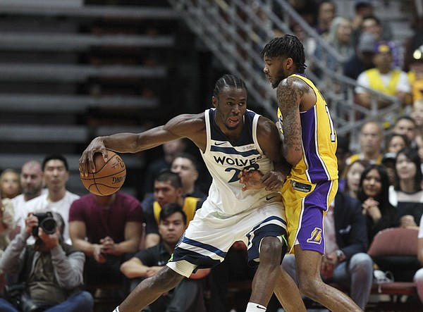 Minnesota Timberwolves forward Andrew Wiggins #22 and Los Angeles Lakers forward Brandon Ingram #14 in actions during an NBA preseason basketball game between Los Angeles Lakers and Minnesota Timberwolves in Anaheim, Calif., Saturday, Sept. 30, 2017. (AP Photo/Ringo H.W. Chiu)