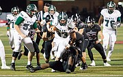 Free State junior running back Jax Dineen tries to break away from Lawrence defensive lineman E.J. Jewsome during the City Showdown on Friday, Oct. 20, 2017 at LHS.