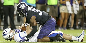 TCU linebacker Travin Howard (32) gets up off of Kansas quarterback Peyton Bender (7) after sacking him during the second quarter, Saturday, Oct. 21, 2017 at Amon G. Carter Stadium in Fort Worth.