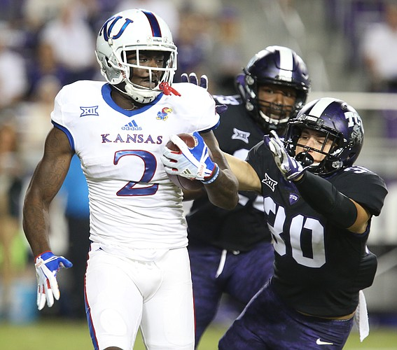 Kansas special teams player Daylon Charlot (2) is pursued by TCU special teams player Garret Wallow (30) during the fourth quarter, Saturday, Oct. 21, 2017 at Amon G. Carter Stadium in Fort Worth.