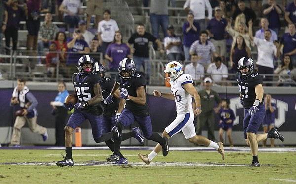 Kansas punter Cole Moos (36) can't catch TCU punt returner KaVontae Turpin (25) as he tears up the field for a touchdown during the third quarter, Saturday, Oct. 21, 2017 at Amon G. Carter Stadium in Fort Worth.