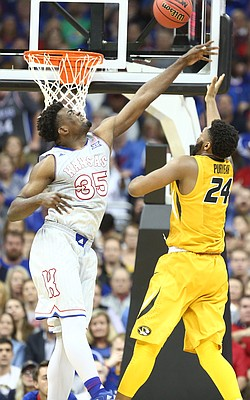Kansas center Udoka Azubuike (35) defends against a shot from Missouri forward Kevin Puryear (24) during the first half of the Showdown for Relief exhibition, Sunday, Oct. 22, 2017 at Sprint Center in Kansas City, Missouri.