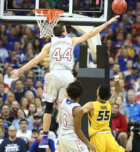 Kansas forward Mitch Lightfoot (44) rejects a shot by Missouri guard Blake Harris (55) during the first half of the Showdown for Relief exhibition, Sunday, Oct. 22, 2017 at Sprint Center in Kansas City, Missouri.