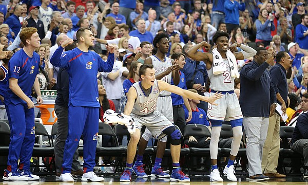 The Kansas bench reacts to a dunk by center Udoka Azubuike during the second half of the Showdown for Relief exhibition, Sunday, Oct. 22, 2017 at Sprint Center in Kansas City, Missouri.