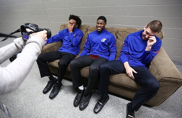 Kansas guards Devonte' Graham, left, and Sviatoslav Mykhailiuk, right, laugh as Malik Newman conducts an interview with a KU Athletics staff member during Big 12 Media Day, Tuesday, Oct. 24, 2017 at Sprint Center in Kansas City, Mo.