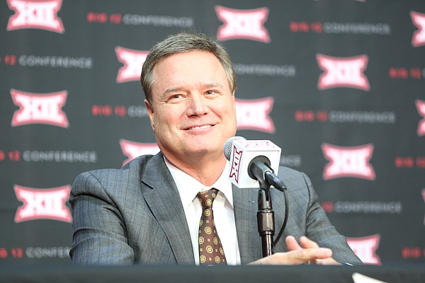 Kansas head coach Bill Self smiles as he takes questions from media members during Big 12 Media Day, Tuesday, Oct. 24, 2017 at Sprint Center in Kansas City, Mo.