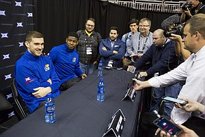 Kansas guard Malik Newman taps teammate Sviatoslav Mykhailiuk on the shoulder to answer a question before reporters during Big 12 Media Day, Tuesday, Oct. 24, 2017 at Sprint Center in Kansas City, Mo.