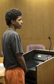 Defendant Ahmad Rayton, 22, of Topeka, appears before Douglas County District Court Judge Sally Pokorny on Wednesday, Oct. 25, 2017 in the Division Six courtroom. Rayton is charged with one count of attempted second-degree murder during an Oct. 1 shooting in downtown Lawrence that left three dead.