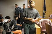 Defendant Anthony L. Roberts Jr. is called to appear before Douglas County District Court Judge Sally Pokorny on Wednesday, Oct. 25, 2017 in the Division Six courtroom. Roberts, who is accused of murdering three people in downtown Lawrence on Oct. 1, is charged with four felony counts in the case. Two other defendants in the incident also appeared in the courtroom Wednesday — Dominique J. McMillon, seated in back, and Ahmad Rayton, seated in front.