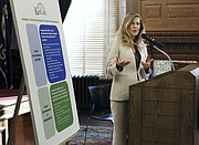 Kansas Department of Health and Environment Secretary Susan Mosier unveils KanCare 2.0, Friday, Oct. 27, 2017, during a news conference at the statehouse in Topeka, Kan. (Thad Allton /The Topeka Capital-Journal via AP)
