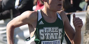 Free State sophomore Charlie Johnson closes in on the finish line in the Class 6A boys race of the state cross country meet on Saturday at Rim Rock Farm. Johnson clocked in with a personal-best time of 16:57, which was good for 41st place.
