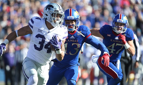 Kansas cornerback Hasan Defense (13) chases down Kansas State running back Alex Barnes (34) during the second quarter on Saturday, Oct. 28, 2017 at Memorial Stadium.