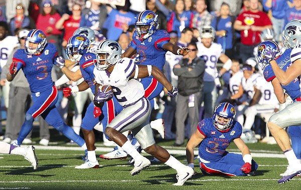 Kansas State kickoff returner D.J. Reed (2) escapes several Kansas special teams players during the fourth quarter on Saturday, Oct. 28, 2017 at Memorial Stadium.