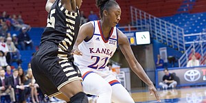 Kansas senior forward Chayla Cheadle (22) makes a spin move against Emporia State's Tyra Jones (35) during Sunday's exhibition game at Allen Fieldhouse.
