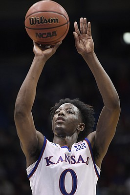 Kansas freshman guard Marcus Garrett makes a free throw to break 100 points in an exhibition game against Pittsburg State on Tuesday at Allen Fieldhouse.