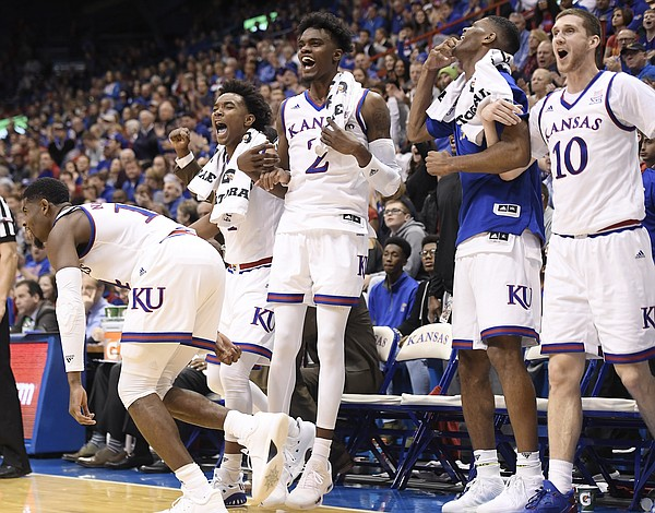 The Kansas bench erupts after a basket by Clay Young in an exhibition game against Pittsburg State on Tuesday at Allen Fieldhouse.