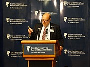 Bob Page, president and CEO of the University of Kansas Health System, announces the completion of a purchase of St. Francis Health Center in Topeka in a partnership with Ardent Health Services of Nashville. The 378-bed facility was in danger of closing earlier this year because of financial troubles.