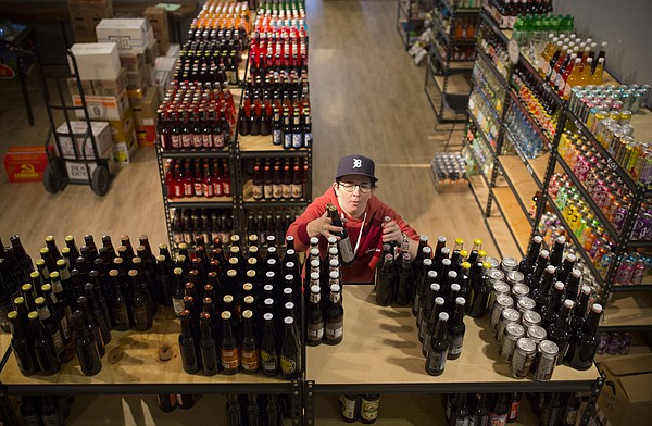 Mass Street Soda store manager Maren Ludwig stocks the selection of root beer on Thursday, Nov. 2, 2017, at the shop's temporary location, 935 Massachusetts St. The store has relocated while its building in the 1100 block of Massachusetts Street undergoes a renovation.