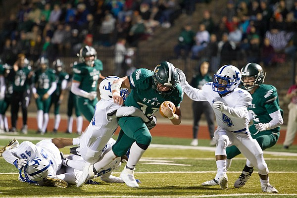 Free State junior running back Jax Dineen tries to break a few tackles against Junction City on Friday at FSHS.