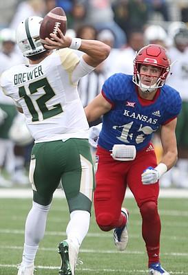 Kansas linebacker Keith Loneker Jr. (47) eyes Baylor quarterback Charlie Brewer (12) during the first quarter on Saturday, Sept. 4, 2017 at Memorial Stadium.
