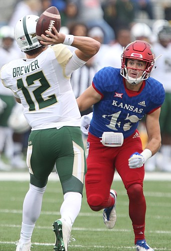 Kansas linebacker Keith Loneker Jr. (47) eyes Baylor quarterback Charlie Brewer (12) during the first quarter on Saturday, Sept. 4, 2017 at Memorial Stadium.