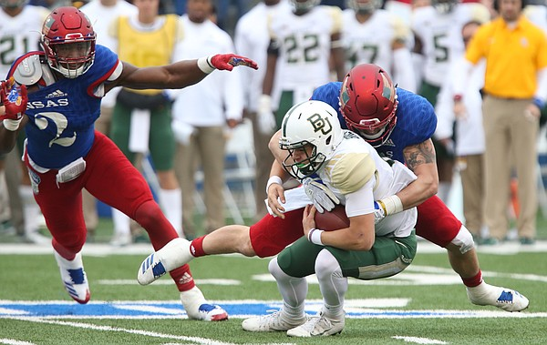 Kansas linebacker Joe Dineen Jr. (29) sacks Baylor quarterback Charlie Brewer (12) during the second quarter on Saturday, Nov.. 4, 2017 at Memorial Stadium. At left is Kansas defensive end Dorance Armstrong Jr. (2).