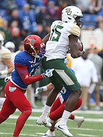 Baylor wide receiver Denzel Mims (15) catches a pass before Kansas cornerback Hasan Defense (13) during the second quarter on Saturday, Sept. 4, 2017 at Memorial Stadium.