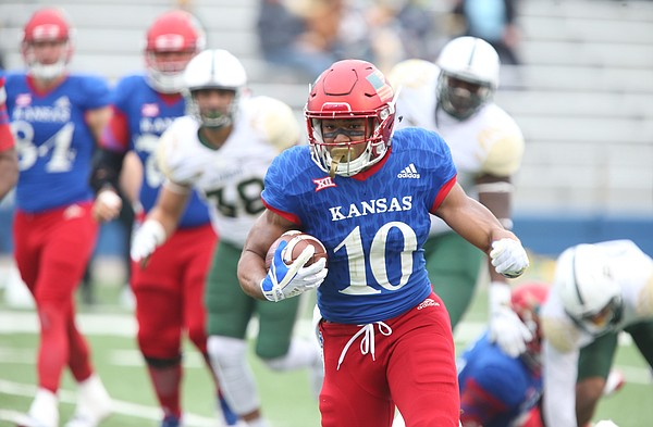 Kansas running back Khalil Herbert (10) takes off on a run during the third quarter on Saturday, Sept. 4, 2017 at Memorial Stadium.