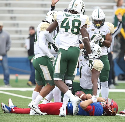 Several Baylor players celebrate over Kansas quarterback Carter Stanley (9) after sacking him during the fourth quarter on Saturday, Sept. 4, 2017 at Memorial Stadium.