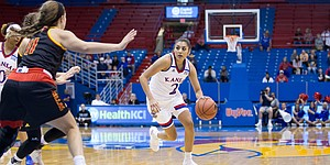 KU junior guard Brianna Osorio looks to drive the ball against Pittsburg State in an exhibition game Sunday at Allen Fieldhouse.