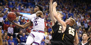 Kansas guard Lagerald Vick (2) gets to the bucket past several Fort Hays State defenders during the first half, Tuesday, Nov. 7, 2017 at Allen Fieldhouse.