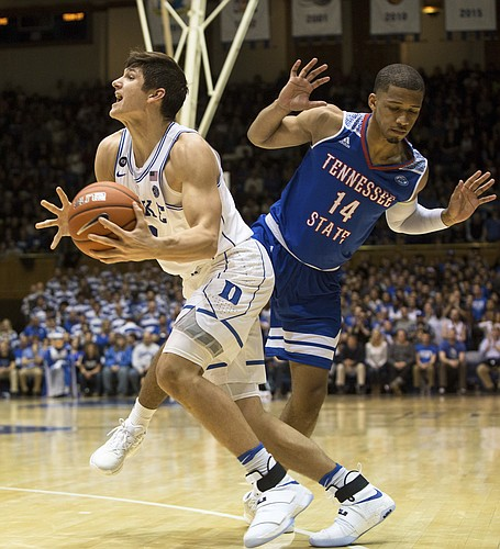 Duke's Grayson Allen, left, handles the ball as Tennessee State's Darreon Reddick (14) defends during the second half of an NCAA college basketball game in Durham, N.C., Monday, Dec. 19, 2016.