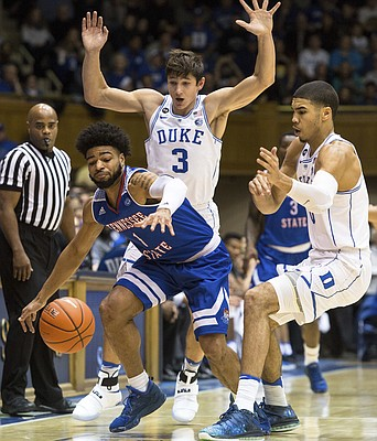 Tennessee State's Delano Spencer (1) loses the ball as Duke's Grayson Allen (3) and Duke's Jayson Tatum (0) defend during the first half of an NCAA college basketball game in Durham, N.C., Monday, Dec. 19, 2016.