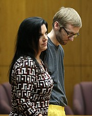 James Fletcher, behind his attorney Sarah Swain, prepares to be led away following his sentencing in Douglas County District Court on Thursday, Nov. 9, 2017.