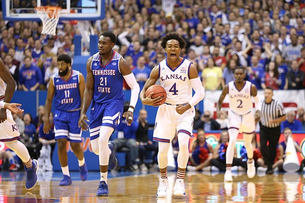 Devonte' Graham screams toward the Allen Fieldhouse crowd after a Jayhawks basket versus Tennessee State.
