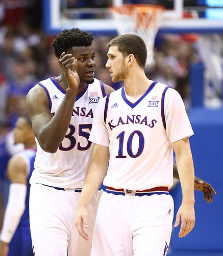 Kansas center Udoka Azubuike (35) and Kansas guard Sviatoslav Mykhailiuk (10) converse during a break in the first half on Friday, Nov. 10, 2017 at Allen Fieldhouse.