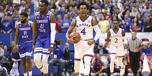 Kansas guard Devonte' Graham (4) roars after two consecutive steals by the Jayhawks against Tennessee State during the first half on Friday, Nov. 10, 2017 at Allen Fieldhouse.