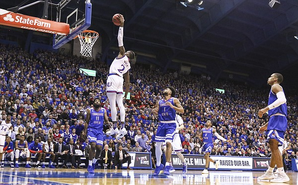 Kansas guard Lagerald Vick (2) floats in for a dunk during the first half on Friday, Nov. 10, 2017 at Allen Fieldhouse.