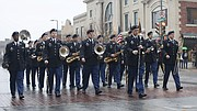Members of the 312th Army Band from Lawrence march in the Veteran's Day parade through downtown Lawrence, Saturday, Nov. 11, 2017.
