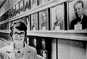 Nancy Hambleton, the first female mayor of Lawrence, stands next to a wall of portraits of previous mayors at City Hall in this 1973 file photo.