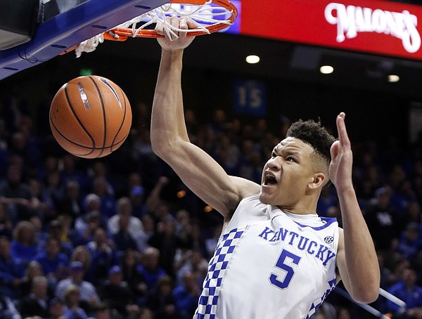 Kentucky's Kevin Knox (5) dunks during the second half of an NCAA college basketball game against Utah Valley, Friday, Nov. 10, 2017, in Lexington, Ky. Kentucky won 73-63.