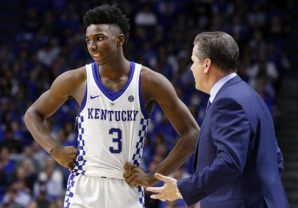 Kentucky's Hamidou Diallo (3) receives instructions from head coach John Calipari during the second half of an NCAA college basketball game against Vermont, Sunday, Nov. 12, 2017, in Lexington, Ky.