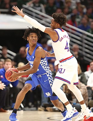 Kansas guard Devonte' Graham (4) pressures Kentucky guard Shai Gilgeous-Alexander (22) during the first half on Tuesday, Nov. 14, 2017 at United Center.