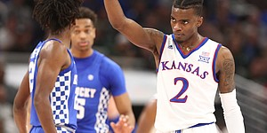 Kansas guard Lagerald Vick (2) signals the other direction after a Kentucky turnover during the first half on Tuesday, Nov. 14, 2017 at United Center.