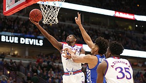 Kansas guard Malik Newman (14) floats to the bucket past Kentucky forward Nick Richards (4) during the first half on Tuesday, Nov. 14, 2017 at United Center.