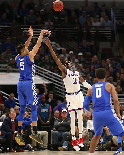 Kentucky forward Kevin Knox (5) puts up a three over Kansas guard Lagerald Vick (2) during the first half on Tuesday, Nov. 14, 2017 at United Center.